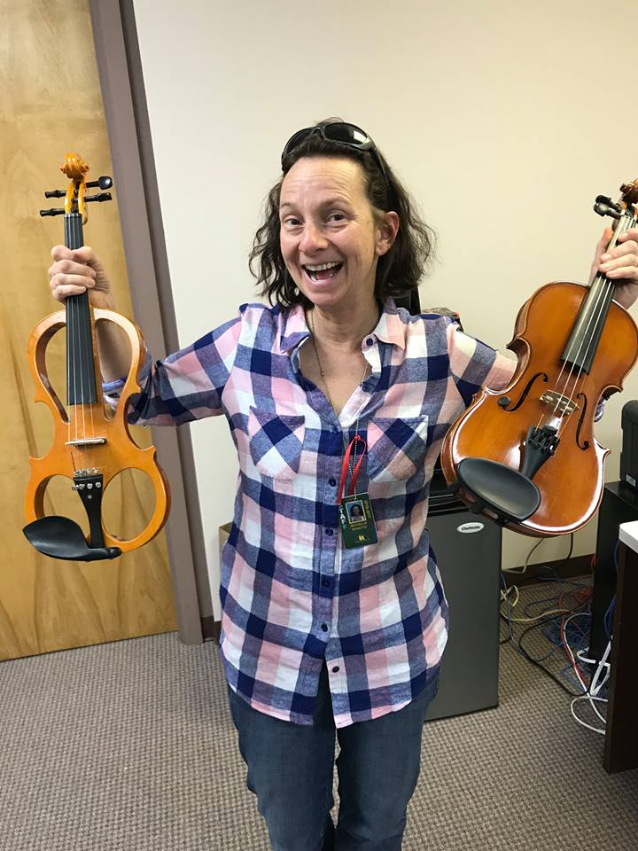 Ms. Rosette with donated violins